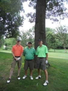 We Care & Share Golf Classic winning team of Christian Faust, Tony Solina, and Brad Duty