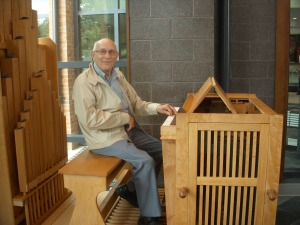 Ben Faidley and the new organ in the Chapel.